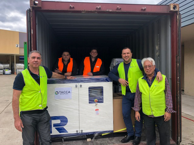 Photo of Tacca Industries team members with new machinery to produce fabric for surgical masks and isolation gowns.